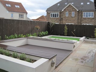 Contemporary rear garden with composite decking and artificial grass by Mike Bradley Garden Design