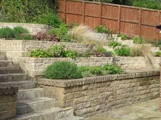 Steeply sloping rear garden - terraced solution by Mike Bradley Garden Design