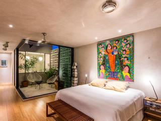Eclectic style bedroom by Taller Estilo Arquitectura Eclectic