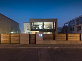 Dom w Poznaniu: styl , w kategorii Domy zaprojektowany przez Fotografia Przemysław Turlej