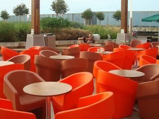 Ambientación de espacios comerciales: Shoppings y centros comerciales de estilo  por Nodobjetos