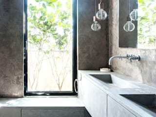 Casas de banho minimalistas por toledano + architects Minimalista Betão