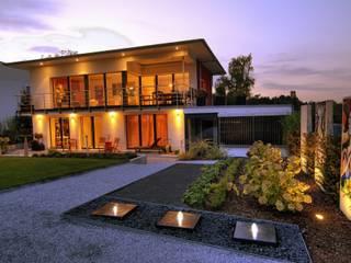 Proyectos bioclimáticos: Casas de estilo ecléctico por Arquitecto Sergio Capua