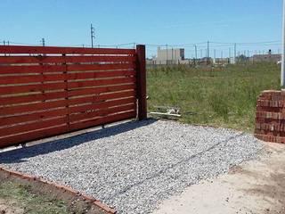 Ingreso a Propiedad (Tierra De Sueños 3) Casas rurales de 'Serenelli Arquitectura-Construcciones' Rural
