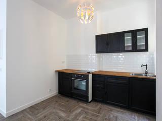 Rénovation appartement Marseillais: Cuisine de style  par ARCHIIMMO