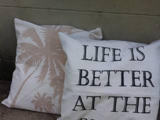 Almohadones para el showroom de Remeros Beach-Tigre:  de estilo  por Indigo Fabrics