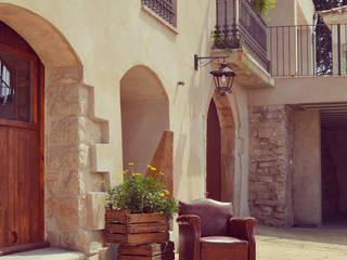 Casas rústicas por raddi ARQUITECTES Rústico