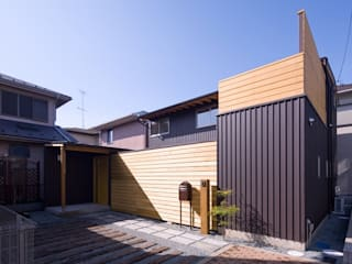 Casas de estilo ecléctico de 早田雄次郎建築設計事務所/Yujiro Hayata Architect & Associates Ecléctico