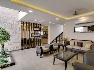 BUDDHA MURAL AND BODHI TREE THEMED INTERIORS FOR A VILLA IN HYDERABAD KREATIVE HOUSE Living roomSofas & armchairs Leather Beige