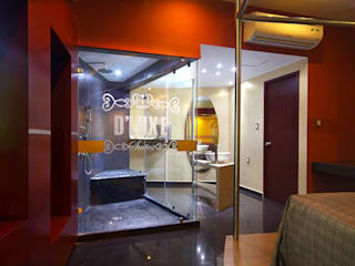 Baños de estilo  de DIN Interiorismo ,