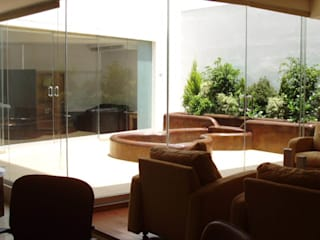 Estudios y despachos de estilo  de DIN Interiorismo ,