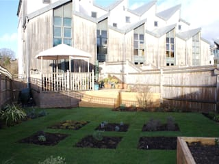 Photo from the rear of the garden towards the elevation of the new development:  Garden by Cowen Garden Design