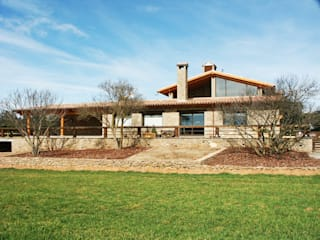 Country style house by RIBA MASSANELL S.L. Country