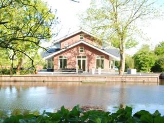Nieuwbouw aan de Zwette in Sneek:  Huizen door Kat Koree Architecten,