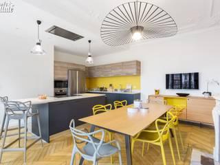Cuisine design jaune Cuisine moderne par Carnets Libellule Moderne