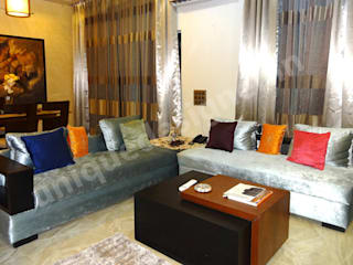 Moderne Wohnzimmer von UNIQUE DESIGNERS & ARCHITECTS Modern