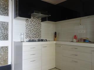 Modern kitchen by UNIQUE DESIGNERS & ARCHITECTS Modern