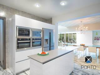 Cozinhas ecléticas por PORTO Arquitectura + Diseño de Interiores Eclético
