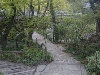 Asian style garden by 作庭衆 熊谷佳樹園 Asian