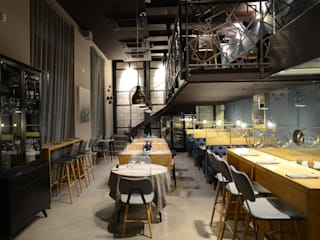 Taverna gourmet Milano Negozi & Locali commerciali in stile industrial di Silvana Barbato Industrial
