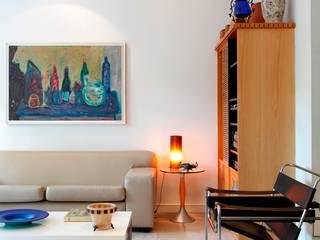Salas de estilo ecléctico de Carlos Salles Arquitetura e Interiores Ecléctico