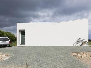 Maison pour un photographe Maisons minimalistes par STUDIO RAZAVI ARCHITECTURE Minimaliste