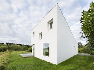 Maison pour un photographe Maisons modernes par STUDIO RAZAVI ARCHITECTURE Moderne