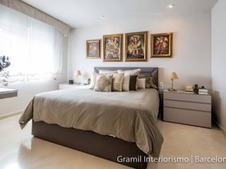 Camera da letto eclettica di Gramil Interiorismo II - Decoradores y diseñadores de interiores Eclettico