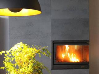 Nowoczesne mieszkanie z betonem architektonicznym Nowoczesny salon od Luxum Nowoczesny
