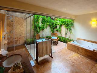 Baños de estilo tropical de José Vigil Arquitectos Tropical