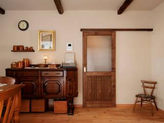 時間に洗練された物とゆっくり時間を過ごす家: 株式会社スタイル工房が手掛けたです。