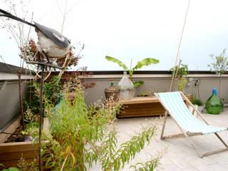 Terrasse de style  par Atelier delle Verdure,