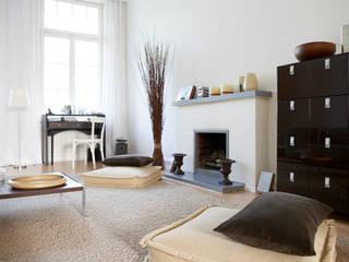 Salas de estar  por Studio Uwe Gaertner Interior Design & Photography