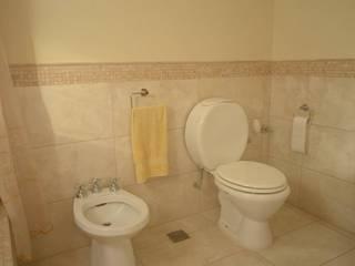 GD Arquitectura, Diseño y Construccion Baños de estilo clásico