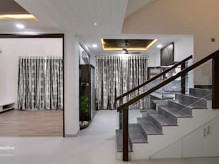 Ground Floor Lounge:  Living room by KREATIVE HOUSE