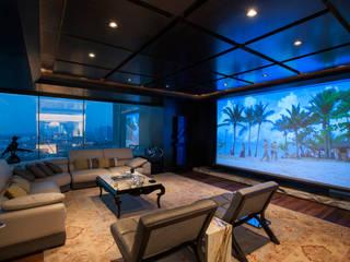 Departamento ASL : Salas multimedia de estilo  por ARCO Arquitectura Contemporánea