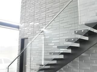 Modern corridor, hallway & stairs by Decoespacios Modern