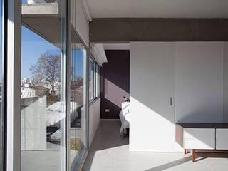 Koridor & Tangga Modern Oleh arquitectos nomaDe Modern