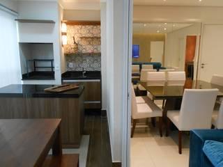 Reforma Apartamento do solteiro: Salas de jantar  por Palladino Arquitetura,