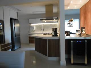 Reforma Apartamento do solteiro: Cozinhas  por Palladino Arquitetura,