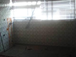 Remodelação de cozinha por Officina de Interiores