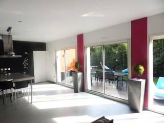 maison contemporaine Bouguenais Salle à manger moderne par Archicosy Moderne