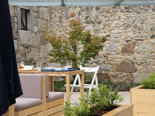 CASINHA BOUTIQUE CAFÉ I VIANA: Espaços de restauração  por Habitat Arquitectura Paisagista,Moderno