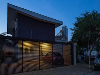 Residência Volpi: Casas  por JAA Arquitetos,