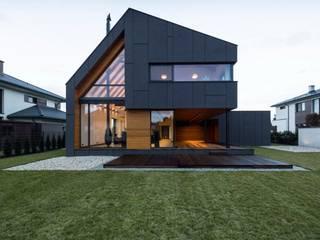 Дома в стиле модерн от BECZAK / BECZAK / ARCHITEKCI Модерн