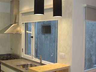 Reforma integral de departamento: Cocinas de estilo moderno por Somos Arquitectura