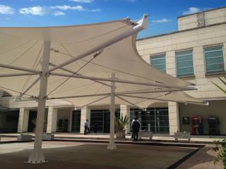 :: MEMBRANA ARQUITECTONICA - BANCO DE LA REPUBLICA :: Jardines de estilo moderno de Diseños & Fachadas SAS Moderno