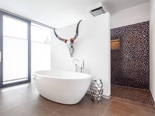 Baños de estilo  por Herzog-Architektur
