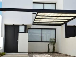 Casas de estilo  de estudio mam3 arquitectos