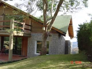 Carlos Eduardo de Lacerda Arquitetura e Planejamento Country style houses Stone
